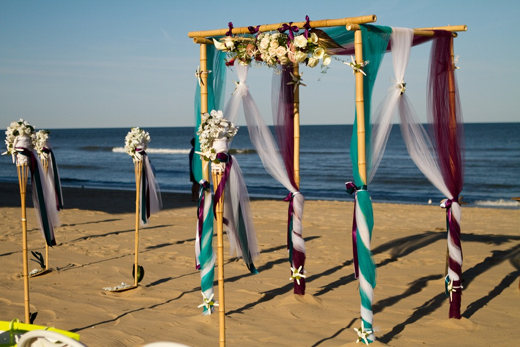 Beach wedding decor ideas bamboo arbors style wedd events los with the right flowers and fabrics you can achieve anything from a stunningly simple scene to an elaborately elegant vignette wedding cabo junglespirit Choice Image