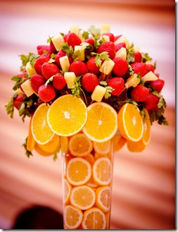 orange and strawberry tall wedding centerpiece
